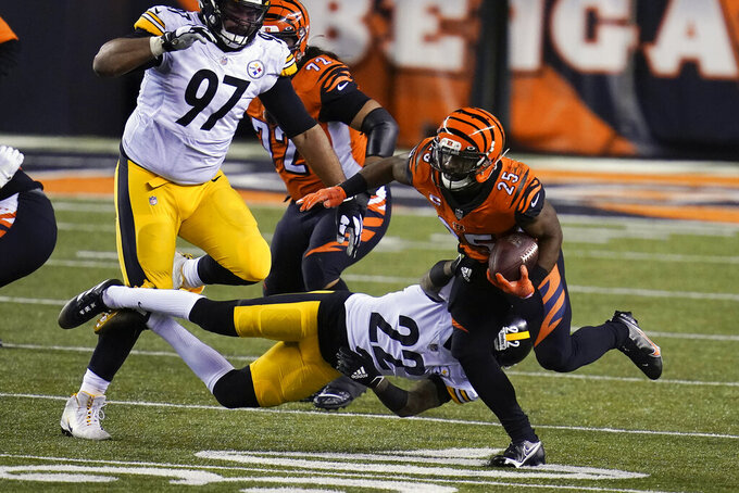 Cincinnati Bengals' Giovani Bernard (25) runs against Pittsburgh Steelers' Steven Nelson (22) during the second half of an NFL football game, Monday, Dec. 21, 2020, in Cincinnati. (AP Photo/Michael Conroy)