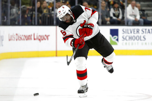 FILE - In this March 3, 2020, file photo, New Jersey Devils defenseman P.K. Subban (76) plays against the Vegas Golden Knights during an NHL hockey game in Las Vegas. Subban and the NHL are bringing something new to television Saturday for fans and everyone dealing with the isolation and hardships caused by the coronavirus pandemic. It's NHL Hat Trick Trivia. Subban is the host of the weekly 30-minute show in which contestants will answer up to three hockey trivia questions for prizes,  the top one being two tickets to any game next season. (AP Photo/John Locher, File)