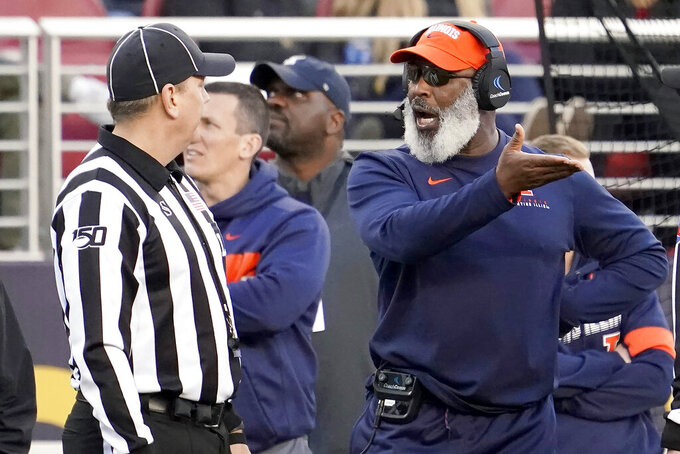 Illinois head coach Lovie Smith, right, argues a call with a line judge during the second half of the Redbox Bowl NCAA college football game against California, Monday, Dec. 30, 2019, in Santa Clara, Calif. (AP Photo/Tony Avelar)
