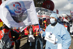 Medical workers demonstrate to demand better salaries and working conditions, Thursday, Oct. 15, 2020 in Paris. French President Emmanuel Macron has announced that millions of French citizens in several regions around the country, including in Paris, will have to respect a 9pm curfew from this Saturday until Dec. 1. It's a new measure aimed at curbing the resurgent coronavirus amid second wave. The measures will require citizens in certain regions where the coronavirus is circulating to be at home after 9pm. (AP Photo/Michel Euler)