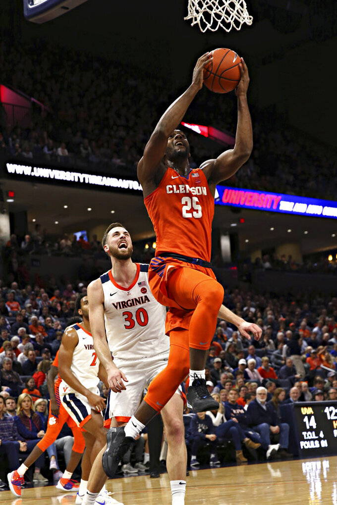 Clemson forward Aamir Simms (25) shoots in front of Virginia's Jay Huffduring an NCAA college basketball game Wednesday, Feb. 5, 2020, in Charlottesville, Va. (Erin Edgerton/The Daily Progress via AP)