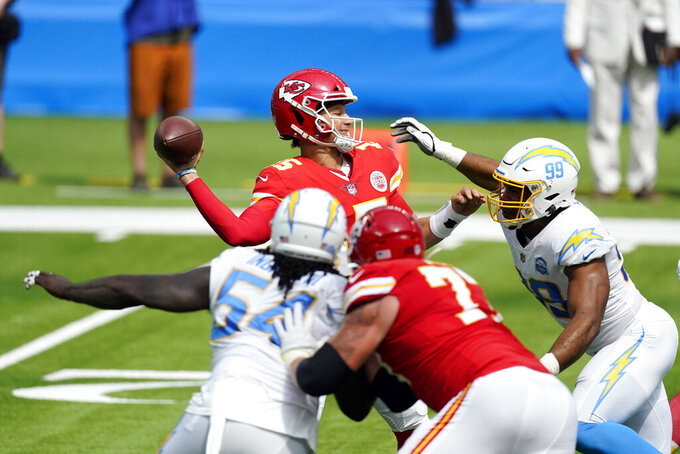 Kansas City Chiefs quarterback Patrick Mahomes throws under pressure agains the Los Angeles Chargers during the first half of an NFL football game Sunday, Sept. 20, 2020, in Inglewood, Calif. (AP Photo/Ashley Landis)