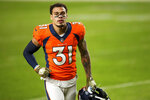 FILE  In this Nov. 22, 2020, file photo, Denver Broncos safety Justin Simmons (31) runs off the field after defeating the Miami Dolphins in an an NFL football game in Denver. Simmons is the first player franchise tagged in 2021. NFL teams have until Tuesday, March 9, 2021, at 4 p.m. ET to use their franchise tag to prevent a pending free agent from hitting the open market. (AP Photo/Justin Edmonds, File)