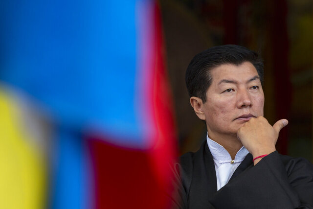 Lobsang Sangay, the president of the Central Tibetan Administration, gestures as he presides over a gathering to mark the anniversary of the 1959 Tibetan uprising in Lhasa, in Dharmsala, India, Tuesday, March 10, 2020. Hundreds of Tibetans had staged a protest in 1959 in the Tibetan capital Lhasa against China's rule. (AP Photo/Ashwini Bhatia)