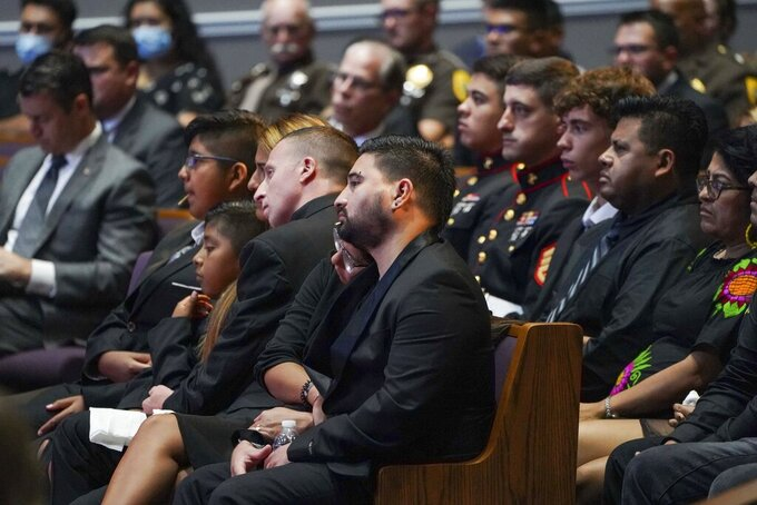 The family of Marine Cpl. Humberto Sanchez waits for the funeral service to begin at LifeGate Church in Logansport, Ind., on Tuesday, Sept. 14, 2021. Sanchez was one of 13 U.S. service members killed in last month's suicide bombing at Afghanistan's Kabul airport during the U.S.-led evacuation.  (Jonah Hinebaugh/The Pharos-Tribune via AP)