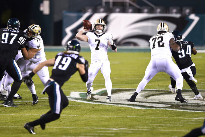 New Orleans Saints' Taysom Hill passes during the first half of an NFL football game against the Philadelphia Eagles, Sunday, Dec. 13, 2020, in Philadelphia. (AP Photo/Derik Hamilton)