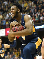 UNC-Greensboro forward Mohammed Abdulsalam (4) celebrates grabbing a rebound against Wofford in the first half of an NCAA college basketball game for the Southern Conference tournament championship, Monday, March 11, 2019, in Asheville, N.C. (AP Photo/Kathy Kmonicek)