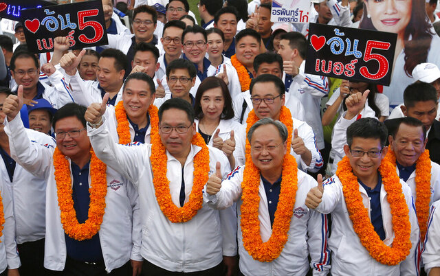 FILE - in this March 22, 2019, file photo, from left to right, Thailand's Suwit Mesinsee, Uttama Savanayana, Sontirat Sontijirawong and Kobsak Pootrakul, arrive for a campaign rally ahead of general elections in Bangkok, Thailand. Four key ministers in Cabinet announced their resignations Thursday, July 16, 2020 as a military clique within the ruling party continues to consolidate power. The most prominent member to depart was Somkid, a deputy prime minister who has been in several governments during the past 19 years and who has been overseeing recent economic stimulus packages. (AP Photo/Sakchai Lalit, File)