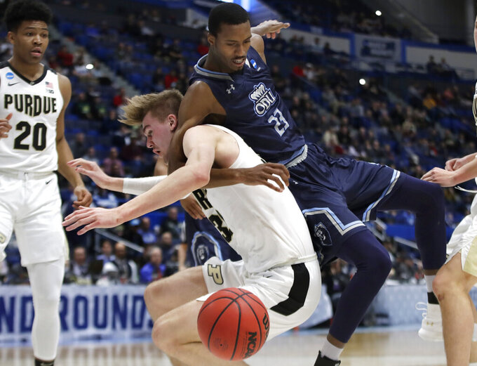 Old Dominion's Dajour Dickens (23) and Purdue's Matt Haarms compete for a rebound as Purdue's Nojel Eastern (20) watches during the second half of a first-round game in the NCAA men's college basketball tournament Thursday, March 21, 2019, in Hartford, Conn. Purdue won 61-48. (AP Photo/Elise Amendola)