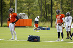 Chicago Bears quarterbacks Nick Foles (9) and Mitchell Trubisky (10) participate in a drill during NFL football training camp at Halas Hall on Tuesday, Sept. 1, 2020, in Lake Forest, Ill.(Dylan Buell/Pool Photo via AP)