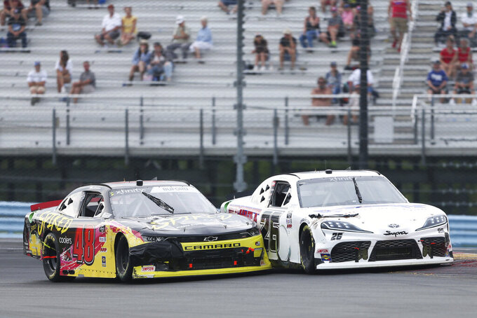 Jade Buford (48) makes contact with Kris Wright as they round Turn 1 in the NASCAR Xfinity Series auto race at Watkins Glen International in Watkins Glen, N.Y., on Saturday, Aug. 7, 2021. (AP Photo/Joshua Bessex)