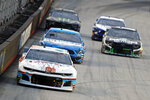 Chase Elliott (9) leads Kevin Harvick and others down the back straight during a NASCAR Cup Series auto race, Saturday, Aug. 17, 2019, in Bristol, Tenn. (AP Photo/Wade Payne)