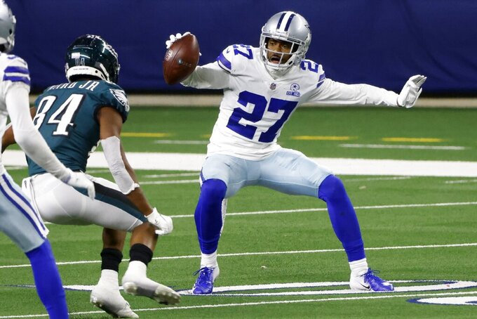 Philadelphia Eagles wide receiver Greg Ward (84) attempts to make the stop as Dallas Cowboys cornerback Trevon Diggs (27) intercepts a pass thrown by Jalen Hurts in the second half of an NFL football game in Arlington, Texas, Sunday, Dec. 27. 2020. (AP Photo/Michael Ainsworth)