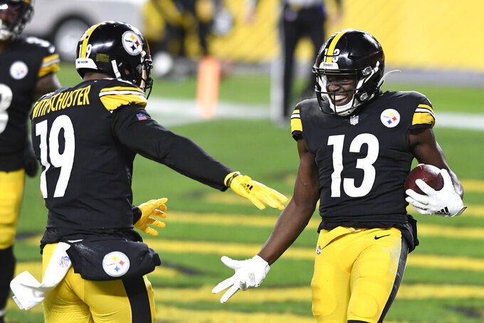 Pittsburgh Steelers wide receiver James Washington (13) celebrates with JuJu Smith-Schuster after scoring on a 50-yard pass play during the first half of an NFL football game against the Washington Football Team in Pittsburgh, Monday, Dec. 7, 2020. (AP Photo/Barry Reeger)