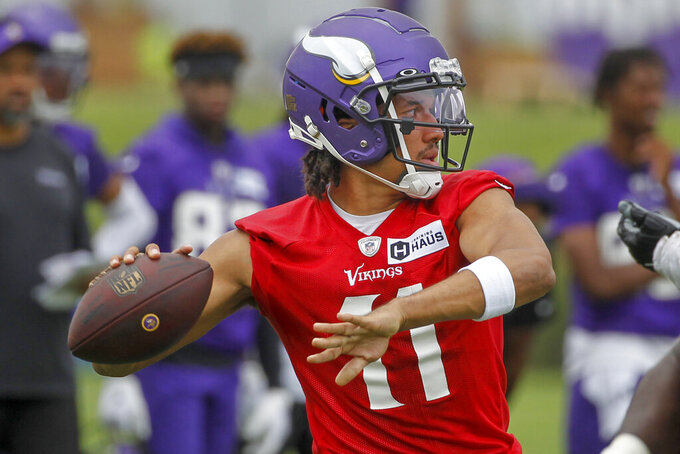 Minnesota Vikings quarterback Kellen Mond throws during NFL football training camp Wednesday, July 28, 2021, in Eagan, Minn. (AP Photo/Bruce Kluckhohn)