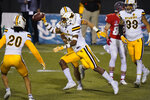 Wyoming cornerback C.J. Coldon (21) celebrates after making an interception against New Mexico during the first half of an NCAA college football game Saturday, Dec. 5, 2020, in Las Vegas. (AP Photo/John Locher)