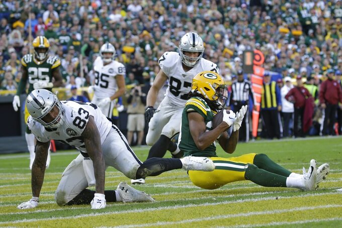 Green Bay Packers' Kevin King intercepts a pass in the end zone during the second half of an NFL football game against the Oakland Raiders Sunday, Oct. 20, 2019, in Green Bay, Wis. (AP Photo/Jeffrey Phelps)