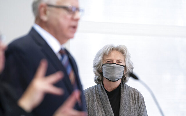 Health Commissioner Jan Malcolm listens as Minnesota Gov. Tim Walz speaks during a news conference on COVID-19 alongside state health officials, Monday, Nov. 16, 2020. (Glen Stubbe/Star Tribune via AP)