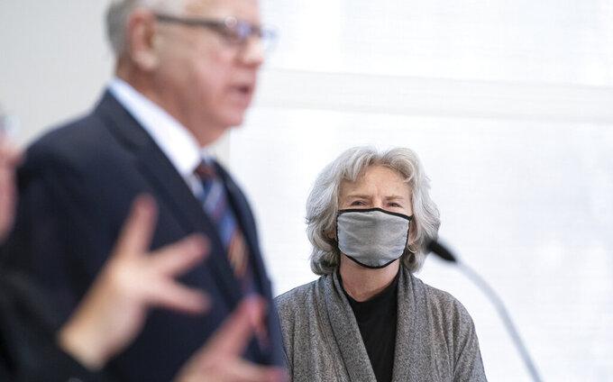 Health Commissioner Jan Malcolm listens as Minnesota Gov. Tim Walz speaks during a news conference on COVID-19 alongside state health officials, Monday, Nov. 16, 2020. (Glen Stubbe/Star Tribune via AP)