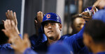 Chicago Cubs' Anthony Rizzo celebrates with with teammates in the dugout after hitting a two-run home run against the Los Angeles Dodgers during the ninth inning of a baseball game in Los Angeles, Saturday, June 15, 2019. The Cubs won 2-1. (AP Photo/Alex Gallardo)