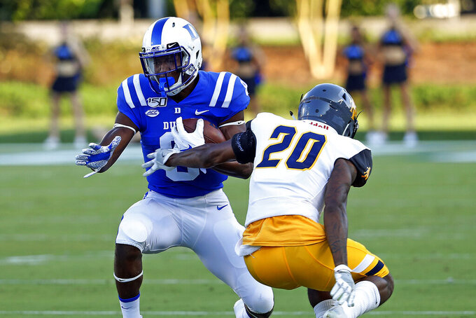Duke's Brittain Brown (8) pulls away from North Carolina A&T's Najee Reams (20) during the first half of an NCAA college football game in Durham, N.C., Saturday, Sept. 7, 2019. (AP Photo/Karl B DeBlaker)