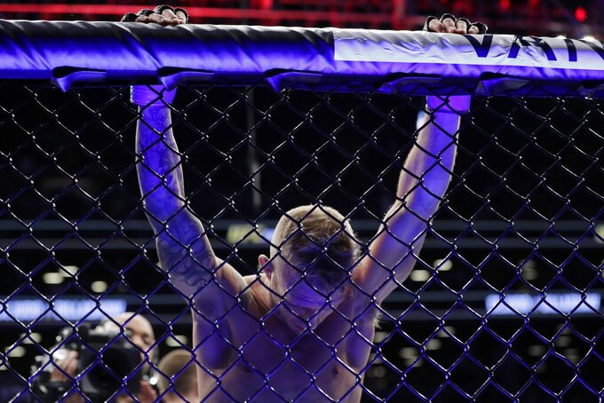 TJ Dillashaw reacts after losing a flyweight mixed martial arts championship bout against Henry Cejudo at UFC Fight Night early Sunday, Jan. 20, 2019, in New York. Cejudo stopped Dillashaw in the first round. (AP Photo/Frank Franklin II)