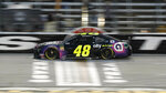 Jimmie Johnson drives across the start-finish line during qualifying for the NASCAR Cup Series auto race at Texas Motor Speedway in Fort Worth, Texas, Friday, March 29, 2019. (AP Photo/LM Otero)