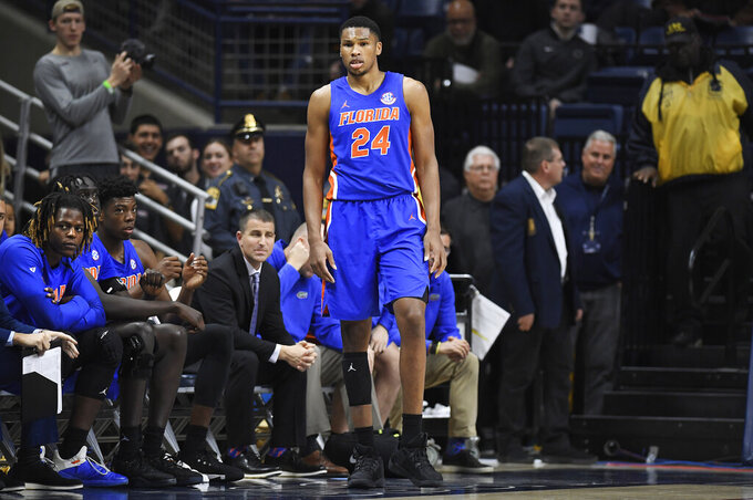 Florida's Kerry Blackshear Jr. watches play after fouling out during the second half of an NCAA college basketball game against Florida, Sunday, Nov. 17, 2019, in Storrs, Conn. (AP Photo/Jessica Hill)