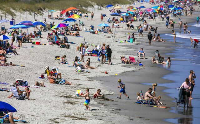 The view to the north from Myrtle Beach State Park Pier on Saturday, May 16, 2020 in Myrtle Beach, S.C. With hotels, beaches, shopping and restaurants reopening along the Grand Strand, tourist season kicked off this weekend despite coronavirus concerns.(Jason Lee/The Sun News via AP)