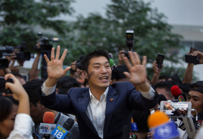 Thanathorn Juangroongruangkit leader of the anti-military Future Forward Party gestures as he leaves Constitutional Court in Bangkok, Thailand, Wednesday, Nov. 20, 2019. Thailand's Constitutional Court ruled Wednesday that Thanathorn violated election laws and cannot keep his seat in Parliament. (AP Photo/Gemunu Amarasinghe)