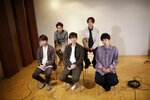 Members of Japanese pop music band ARASHI listen to a question during an interview with The Associated Press in Tokyo on Thursday, Sept. 17, 2020. Back row, from left, clockwise, are Satoshi Ohno, Masaki Aiba, Kazunari Ninomiya, Jun Matsumoto and Sho Sakurai. The Japanese pop sensation has a big surprise for fans as they near their planned hiatus at year's end: a collaboration with Bruno Mars on their first all-English single.(AP Photo/Hiro Komae)