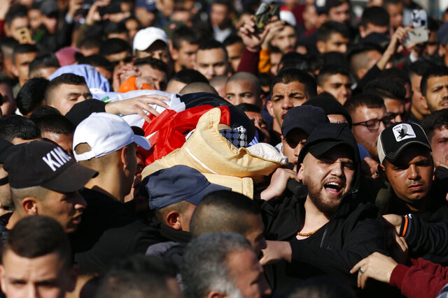 Palestinians carry the body of Yazan Abu Tabekh during his funeral in the West Bank city of Jenin, Thursday, Feb. 6, 2020. The 19-year-old Palestinian was killed in clashes with Israeli troops, according to Palestinian hospital officials. (AP Photo/Majdi Mohammed)