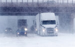 Traffic stops in the eastbound lanes of Interstate 70 near Tower Road as a late winter storm packing hurricane-force winds and snow sweeps over the intermountain West Wednesday, March 13, 2019, in Auora, Colo. (AP Photo/David Zalubowski)