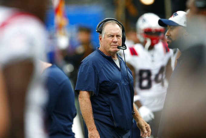 New England Patriots head coach Bill Belichick watches his players during the first half of an NFL preseason football game against the New York Giants Sunday, Aug. 29, 2021, in East Rutherford, N.J. (AP Photo/Noah K. Murray)