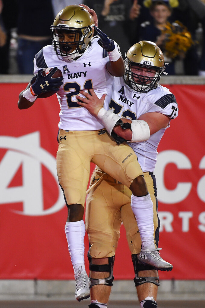 Navy wide receiver Tyreek King-El, left, celebrates his touchdown with Ford Higgins during the second half of an NCAA college football game against Houston, Saturday, Nov. 30, 2019, in Houston. (AP Photo/Eric Christian Smith)