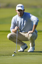 Patrick Cantlay lines up his putt on the 12th green of the Monterey Peninsula County Club Shore Course during the second round of the AT&T Pebble Beach National Pro-Am golf tournament Friday, Feb. 7, 2020, in Pebble Beach, Calif. (AP Photo/Tony Avelar)