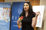 Joan Siff, president of World Against Toys Causing Harm, talks about the danger from strangulation of a pull-along caterpillar toy for infants during a news conference unveiling the organization's list of worst toys for the holidays, Tuesday, Nov. 19, 2019, in Boston. (AP Photo/Michael Dwyer)
