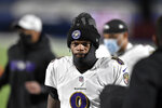 FILE - Baltimore Ravens quarterback Lamar Jackson (8) leaves the field after the first half of an NFL divisional round football game against the Buffalo Bills in Orchard Park, N,Y., in this Saturday, Jan. 16, 2021, file photo. Ravens general manager Eric DeCosta has already started making some of the tough decisions he believes can help Baltimore negotiate the leap from playoff qualifier to Super Bowl champion. After releasing running back Mark Ingram and quarterback Robert Griffin III last week, DeCosta announced Monday, Jan. 25, 2020, that the Ravens won't re-sign All-Pro long snapper Morgan Cox, the initial component of the highly successful placekicking trio that includes holder Sam Koch and second-team All-Pro Justin Tucker, the most accurate field goal kicker in NFL history.(AP Photo/Adrian Kraus, File)
