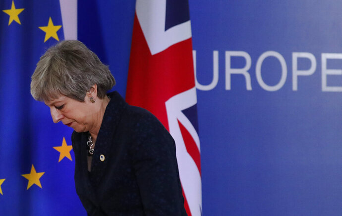 British Prime Minister Theresa May leaves after addressing a media conference at an EU summit in Brussels, Friday, March 22, 2019. Worn down by three years of indecision in London, EU leaders on Thursday were grudgingly leaning toward giving the U.K. more time to ease itself out of the bloc. (AP Photo/Frank Augstein)