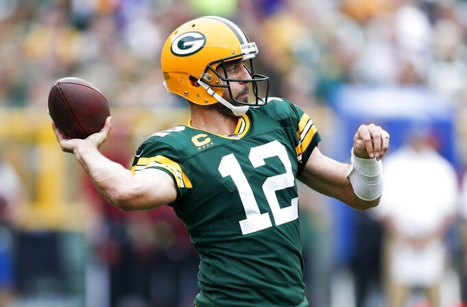 Green Bay Packers' Aaron Rodgers throws during the first half of an NFL football game against the Minnesota Vikings Sunday, Sept. 15, 2019, in Green Bay, Wis. (AP Photo/Matt Ludtke)