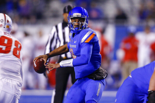 Boise State quarterback Jaylon Henderson (9) looks down field against New Mexico during the second half of an NCAA college football game Saturday, Nov. 16, 2019, in Boise, Idaho. Boise State won 42-9. (AP Photo/Steve Conner)
