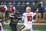 Seattle Seahawks defensive end Alton Robinson (98) pressures San Francisco 49ers quarterback Jimmy Garoppolo during the first half of an NFL football game, Sunday, Nov. 1, 2020, in Seattle. (AP Photo/Scott Eklund)