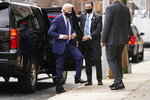 President-elect Joe Biden, wearing a medical boot, leaves his motorcade as he arrives at The Queen theater, Tuesday, Dec. 1, 2020, in Wilmington, Del. (AP Photo/Andrew Harnik)