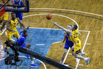 West Virginia guard (22) Sean McNeil shoots against South Dakota State during an NCAA college basketball game Wednesday, Nov. 25, 2020, in Sioux Falls, S.D. (AP Photo/Josh Jurgens)