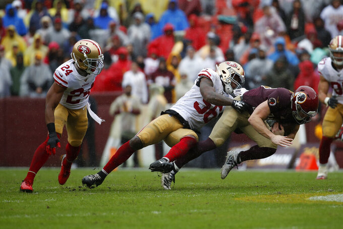 Washington Redskins wide receiver Trey Quinn, right, tries to outrush San Francisco 49ers defensive back K'Waun Williams, left, and San Francisco 49ers middle linebacker Kwon Alexander in the first half of an NFL football game, Sunday, Oct. 20, 2019, in Landover, Md. (AP Photo/Alex Brandon)