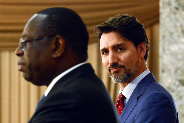 Canadian Prime Minister Justin Trudeau takes part in a joint press conference with President of Senegal Macky Sall at the Presidential Palace in Dakar, Senegal on Wednesday, Feb. 12, 2020. (Sean Kilpatrick/The Canadian Press via AP)
