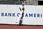 San Francisco Giants' Wilmer Flores makes a leaping catch at the wall on a ball hit by Colorado Rockies' Charlie Blackmon during the fifth inning of a baseball game in San Francisco, Thursday, Sept. 24, 2020. (AP Photo/Jed Jacobsohn)