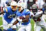 Los Angeles Chargers running back Justin Jackson (22) runs away from Tampa Bay Buccaneers inside linebacker Lavonte David (54) during the first half of an NFL football game Sunday, Oct. 4, 2020, in Tampa, Fla. (AP Photo/Jason Behnken)
