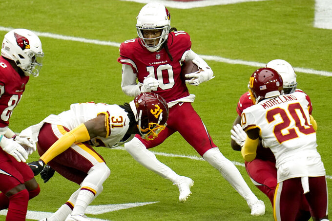 Arizona Cardinals wide receiver DeAndre Hopkins (10) tries to elude Washington Football Team safety Kamren Curl (31) during the first half of an NFL football game, Sunday, Sept. 20, 2020, in Glendale, Ariz. (AP Photo/Ross D. Franklin)