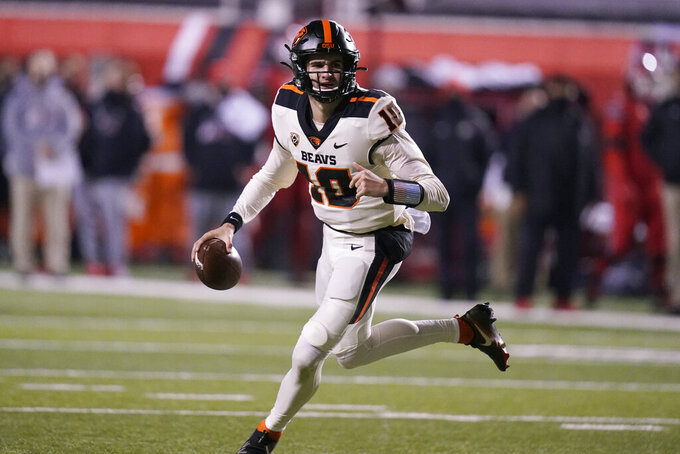Oregon State quarterback Chance Nolan (10) looks downfield during the first half of the team's NCAA college football game against Utah on Saturday, Dec. 5, 2020, in Salt Lake City. (AP Photo/Rick Bowmer)